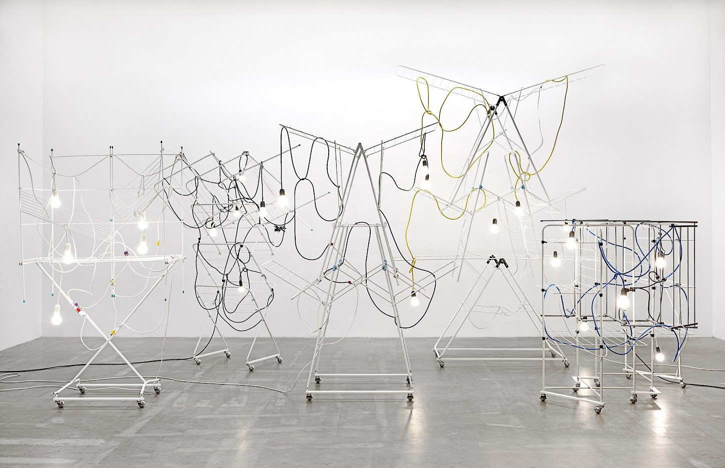 Haegue Yang, Non-Indépliables, nues, 2010/2020. Drying racks, light bulbs, cable, zip ties, terminal strips. Courtesy the artist. Photo: Nick Ash.